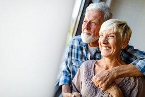 dental implants, older couple hugging