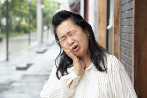 woman suffering from impacted teeth
