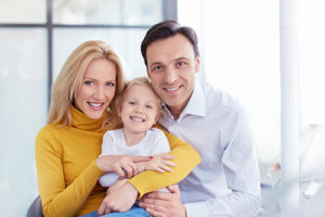 parents with child learning about family dentistry