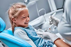 young girl receiving pediatric dentistry services